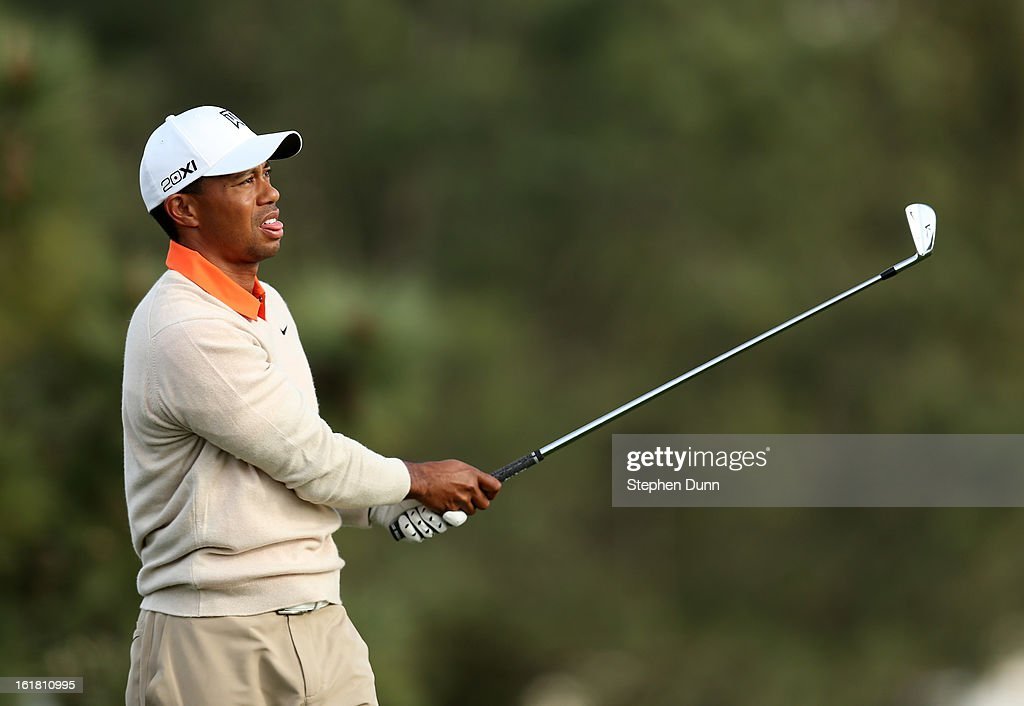 Tiger Woods watches his tee shot on the 16th hole during the first round of the Farmers Insurance Open on the South Course at Torrey Pines Golf Course on January 24, 2013 in La Jolla, California.