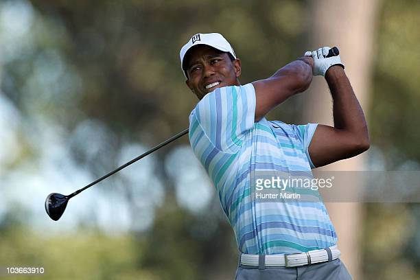 Tiger Woods watches his tee shot on the 16th hole during the second round of The Barclays at the Ridgewood Country Club on August 27 2010 in Paramus...