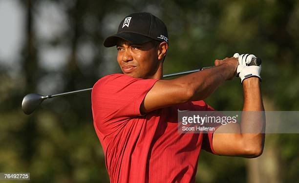 Tiger Woods watches his tee shot on the 17th hole during the final round of the Deutsche Bank Championship, the second event of the new PGA TOUR...