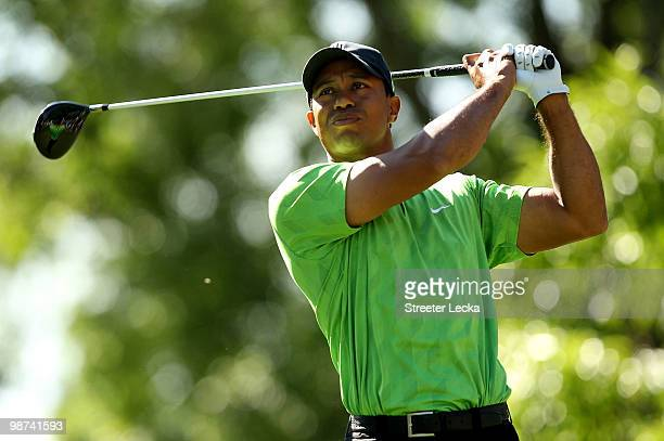 Tiger Woods watches his tee shot on the 18th hole during the first round of the Quail Hollow Championship at Quail Hollow Country Club on April 29...
