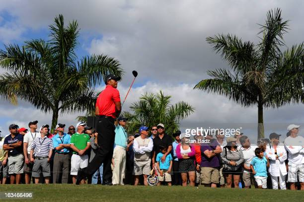 Tiger Woods watches his tee shot on the eighth hole during the final round of the World Golf ChampionshipsCadillac Championship at TPC Blue Monster...