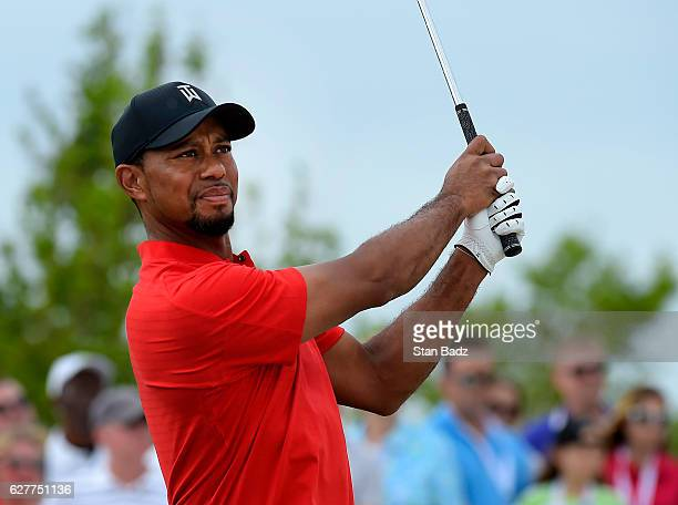 Tiger Woods watches his tee shot on the eighth hole during the final round of the Hero World Challenge at Albany course on December 4 2016 in Nassau...