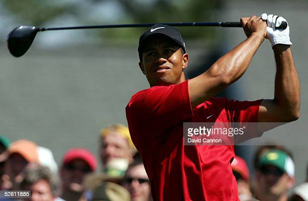 Tiger Woods watches his tee shot on the first hole during the final round of The Masters at the Augusta National Golf Club on April 10 2005 in...