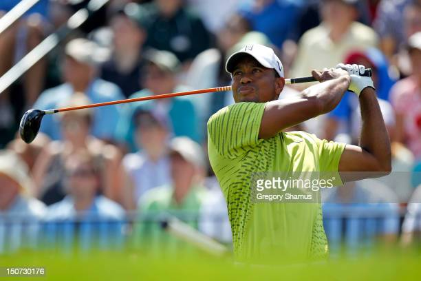 Tiger Woods watches his tee shot on the first hole during the third round of The Barclays at the Black Course at Bethpage State Park August 25 2012...