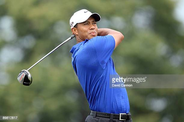 Tiger Woods watches his tee shot on the first hole during the third round of the 91st PGA Championship at Hazeltine National Golf Club on August 15,...