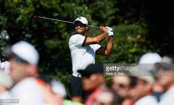 Tiger Woods watches his tee shot on the fourth hole during the second round of the TOUR Championship by CocaCola at East Lake Golf Club on September...