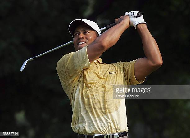 Tiger Woods watches his tee shot on the fourth hole during the third round of the 2005 PGA Championship at Baltusrol Golf Club on August 13 2005 in...