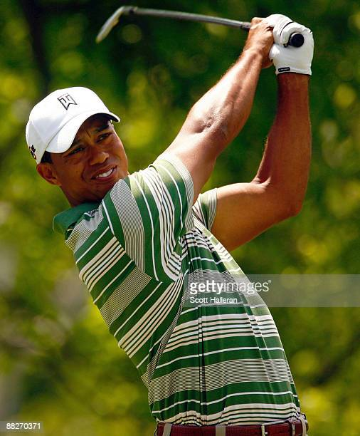 Tiger Woods watches his tee shot on the fourth hole during the third round of the Memorial Tournament at the Muirfield Village Golf Club on June 6,...