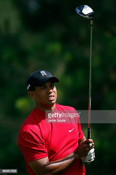 Tiger Woods watches his tee shot on the ninth hole during the final round of THE PLAYERS Championship on THE PLAYERS Stadium Course at TPC Sawgrass...