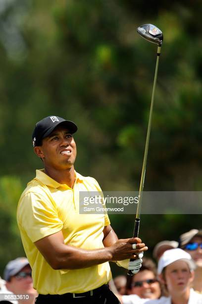 Tiger Woods watches his tee shot on the ninth hole during the second round of THE PLAYERS Championship on THE PLAYERS Stadium Course at TPC Sawgrass...