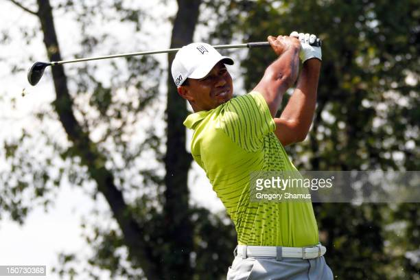 Tiger Woods watches his tee shot on the second during the third round of The Barclays at the Black Course at Bethpage State Park August 25 2012 in...