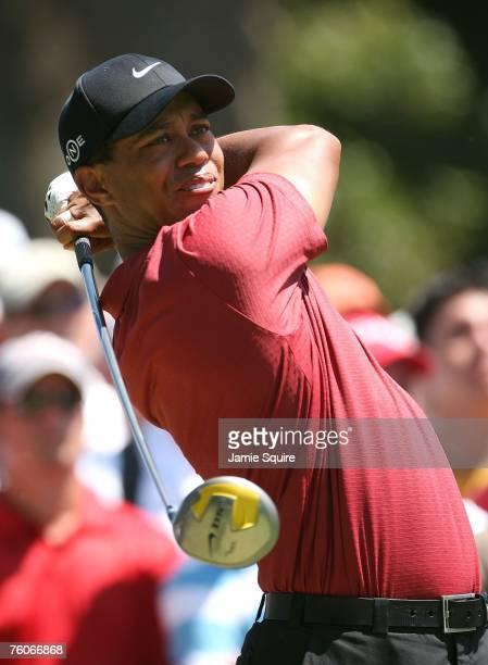 Tiger Woods watches his tee shot on the second hole during the final round of the 89th PGA Championship at the Southern Hills Country Club on August...