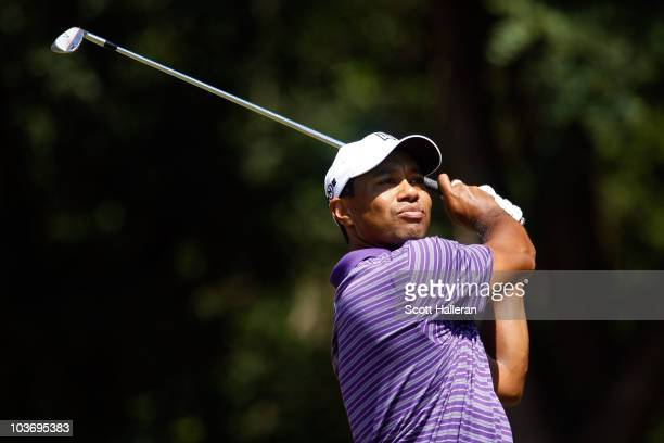 Tiger Woods watches his tee shot on the second hole during the third round of The Barclays at the Ridgewood Country Club on August 28 2010 in Paramus...