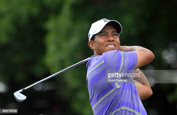 Tiger Woods watches his tee shot on the second hole during the third round of the Arnold Palmer Invitational at the Bay Hill Club & Lodge on March...