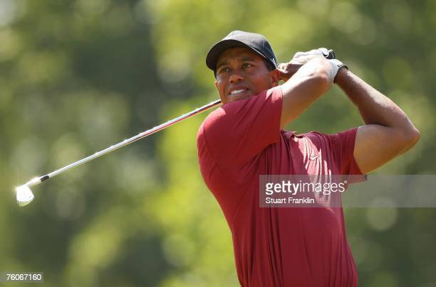 Tiger Woods watches his tee shot on the seventh hole during the final round of the 89th PGA Championship at the Southern Hills Country Club on August...