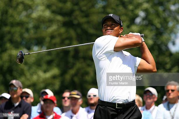 Tiger Woods watches his tee shot on the seventh hole during the first round of the AT&T National at Aronimink Golf Club on July 1, 2010 in Newtown...