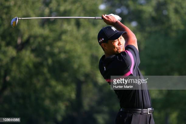 Tiger Woods watches his tee shot on the seventh hole during the first round of The Barclays at the Ridgewood Country Club on August 26 2010 in...