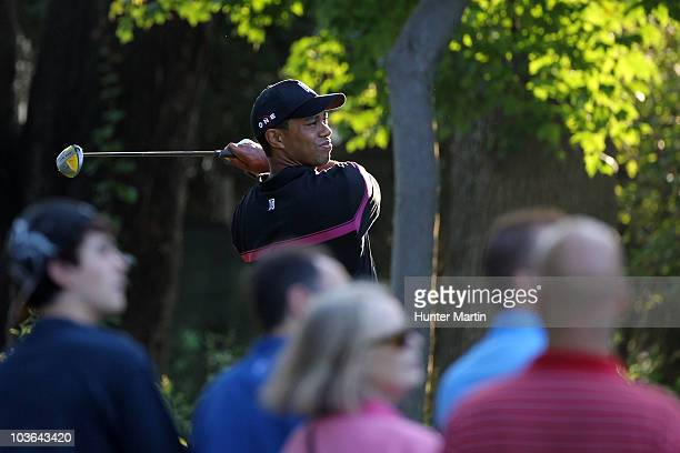 Tiger Woods watches his tee shot on the third hole during the first round of The Barclays at the Ridgewood Country Club on August 26 2010 in Paramus...