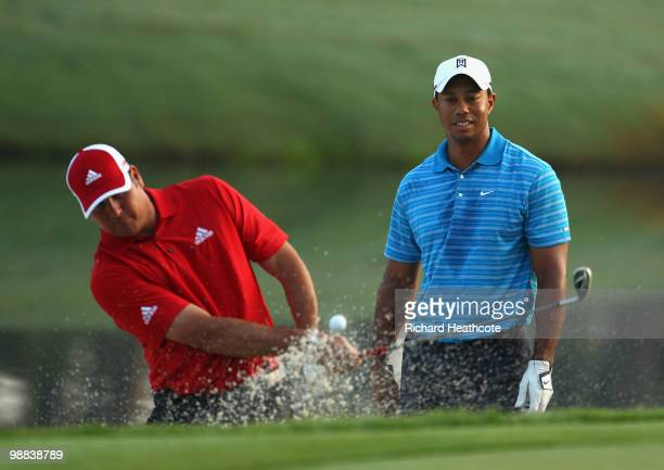 Tiger Woods watches Pat Perez who plays out of a bunker during a practice round prior to the start of THE PLAYERS Championship held at THE PLAYERS...