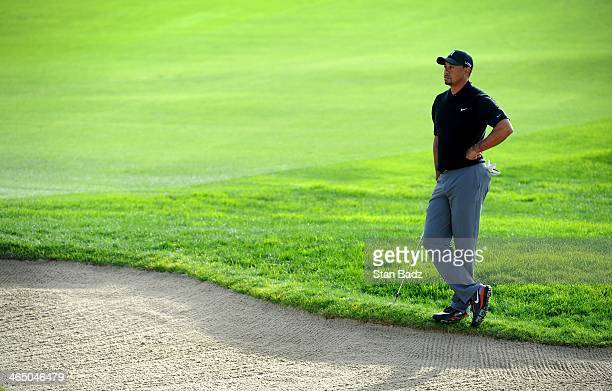 Tiger Woods watches play on the 12th hole during the third round of the Farmers Insurance Open at Torrey Pines Golf Course on January 25 2014 in La...