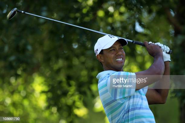 Tiger Woods watches tee shot on the 11th hole during the second round of The Barclays at the Ridgewood Country Club on August 27 2010 in Paramus New...