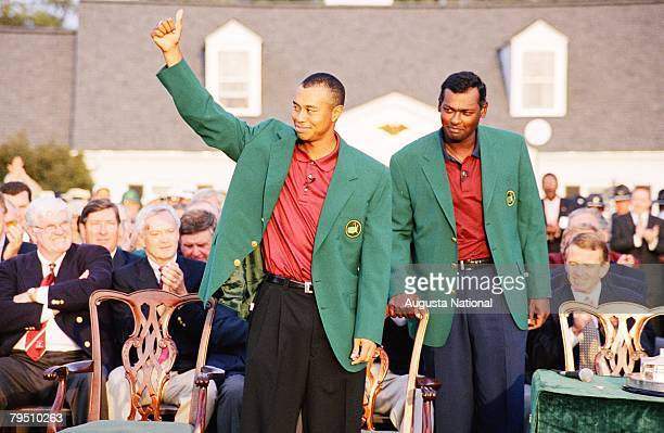 Tiger Woods Waves As Vijay Singh Looks On During The Presentation Ceremony Of The 2001 Masters Tournament