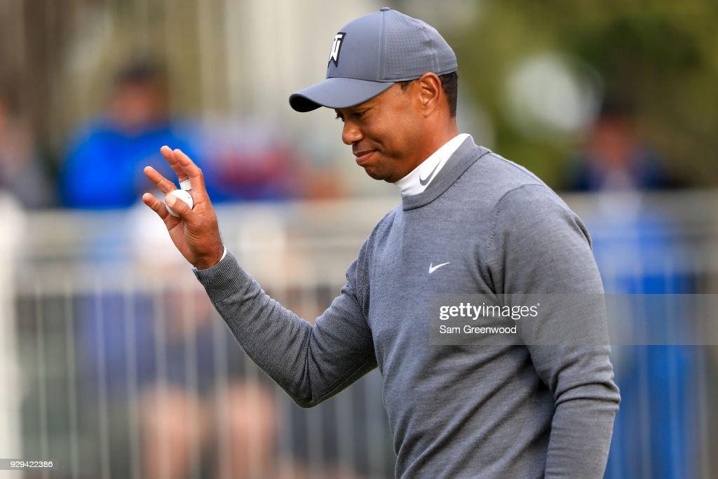Tiger Woods waves to the crowd after a birde putt on the 17th green during the first round of the Valspar Championship at Innisbrook Resort Copperhead Course on March 8, 2018 in Palm Harbor, Florida.