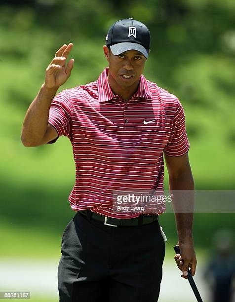 Tiger Woods waves to the crowd after making a birdie on the 4th hole during the final round of the Memorial Tournament on June 7 2009 at the...