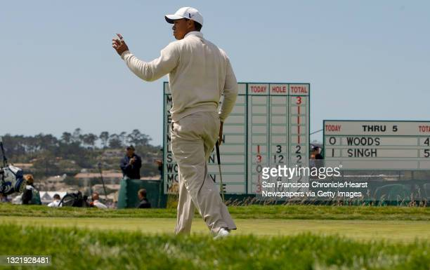 TIger Woods waves to the crowd following his birdie on the par-5 6th hole, during 3rd round action of the 2010 US Open Golf tournament at Pebble...