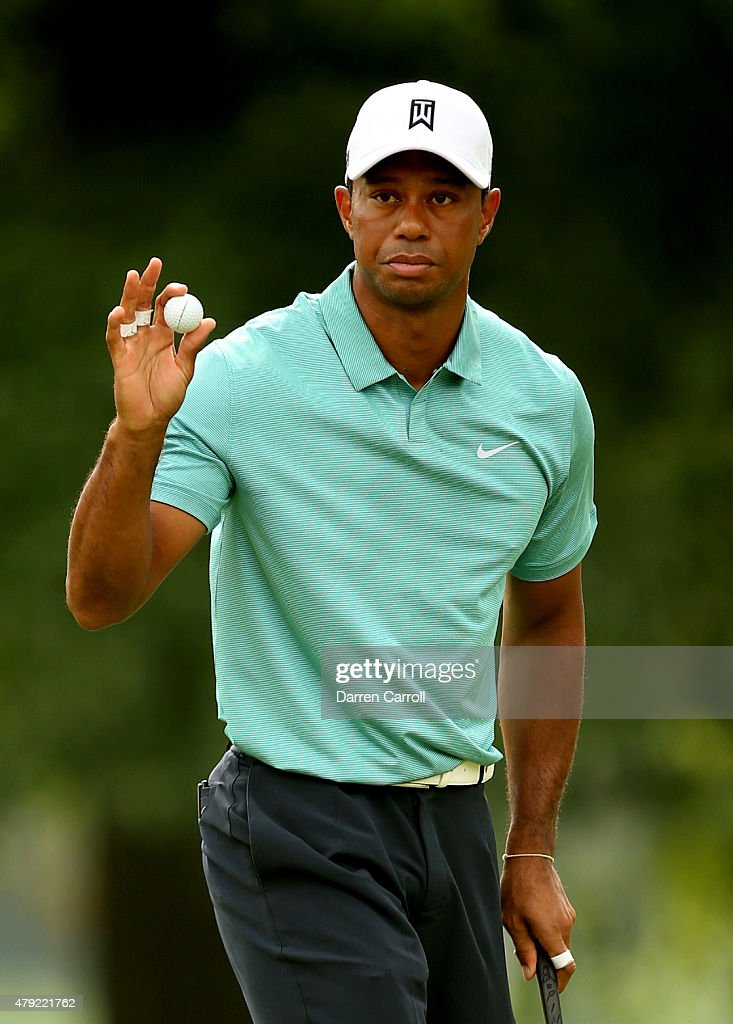 Tiger Woods waves to the gallery after making his putt on the 16th hole during the first round of the Greenbrier Classic at the Old White TPC on July 2, 2015 in White Sulphur Springs, West Virginia.