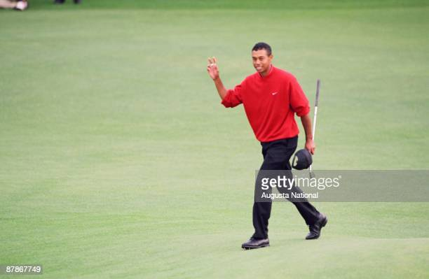 Tiger Woods waves to the gallery during the 1997 Masters Tournament at Augusta National Golf Club in April in Augusta Georgia