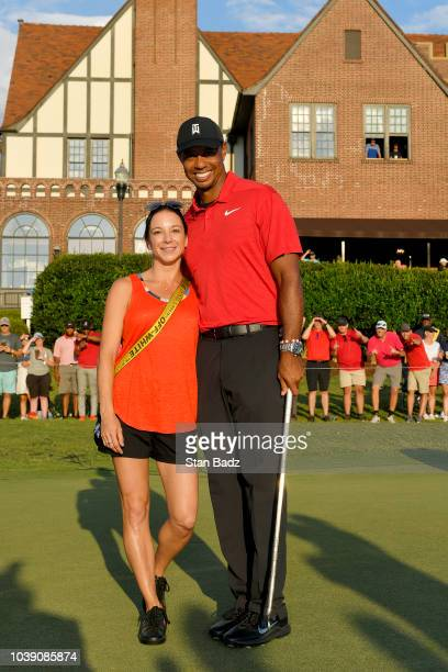 Tiger Woods winner of the TOUR Championship with his girlfriend Erica Herman after the final round of the TOUR Championship at East Lake Golf Club on...