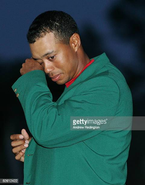 Tiger Woods wipes a tear back during the green jacket presentation after Woods won The Masters at the Augusta National Golf Club on April 10 2005 in...