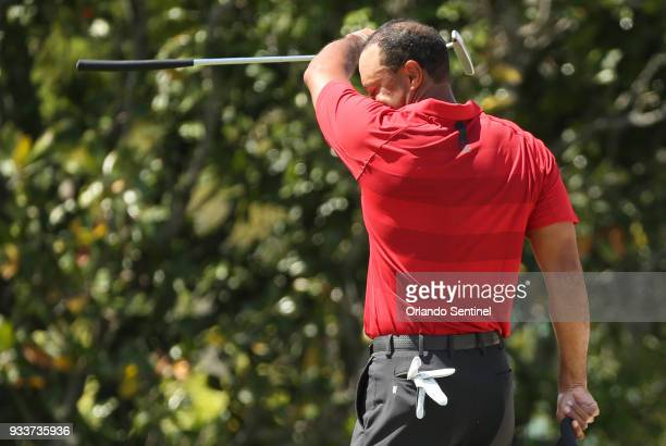 Tiger Woods wipes his brow after a putt during the Arnold Palmer Invitational on Sunday March 18 2018 at Bay Hill Club Lodge in Orlando Fla