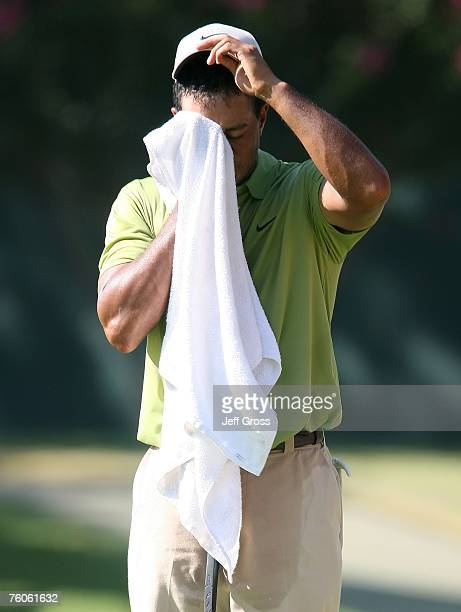 Tiger Woods wipes his face with his towel during the third round of the 89th PGA Championship at the Southern Hills Country Club on August 11 2007 in...