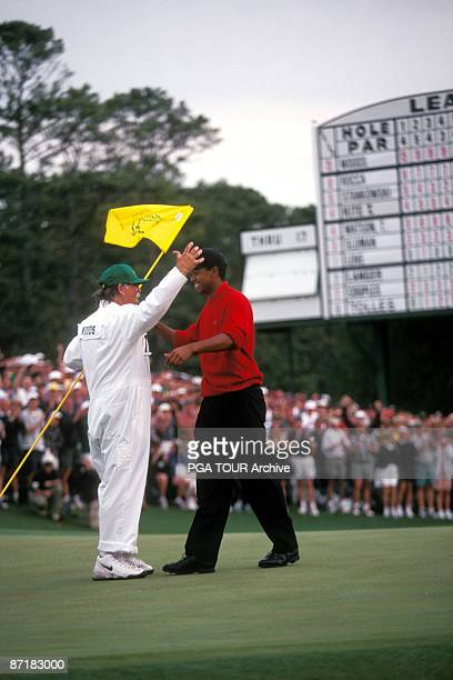 Tiger Woods with caddy at the 1997 Masters Tournament at the Augusta National Golf Club in Augusta Georgia April 1997