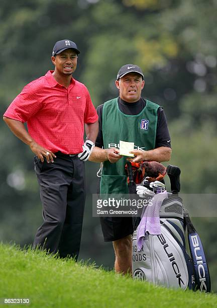 Tiger Woods with his caddie Steve Williams during the final round of the Buick Open at Warwick Hills Golf and Country Club in Grand Blanc Michigan on...