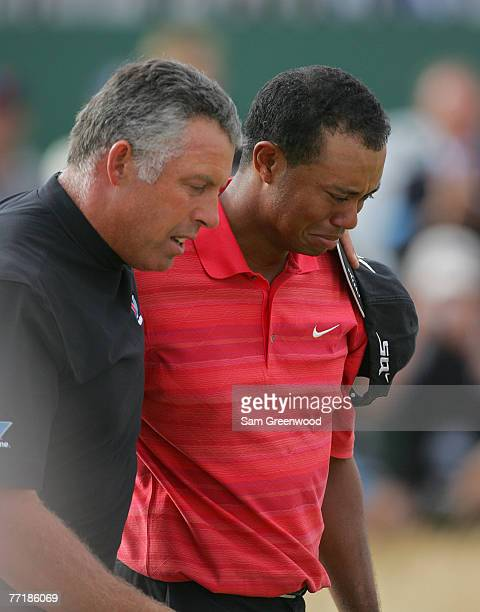 Tiger Woods with his caddie Steve Williams walks off the 18th green crying after winning the 135th Open Championship at Royal Liverpool Golf Club in...