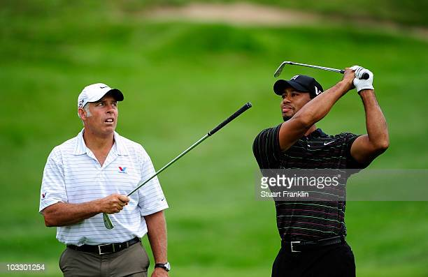 Tiger Woods works on his golf swing with his caddie Steve Williams during a practice round prior to the start of the 92nd PGA Championship on the...