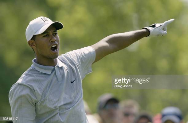 Tiger Woods yells fore after an errant tee shot on the ninth hole during the third round of the Wachovia Championship at the Quail Hollow Club on May...