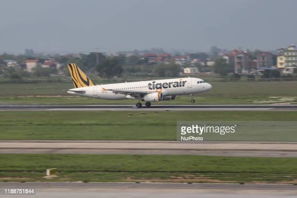 Tigerair Airbus A320 airplane with registration 9VTAV as seen on final approach landing at the capital of Vietnam Noi Bai International Airport HAN...