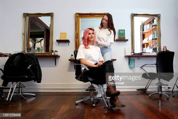 Tigerlily has half her hair dyed as part of the Halfcut fundraising movement at Stanley and Co Barber Shop in Chippendale on June 22, 2020 in Sydney,...