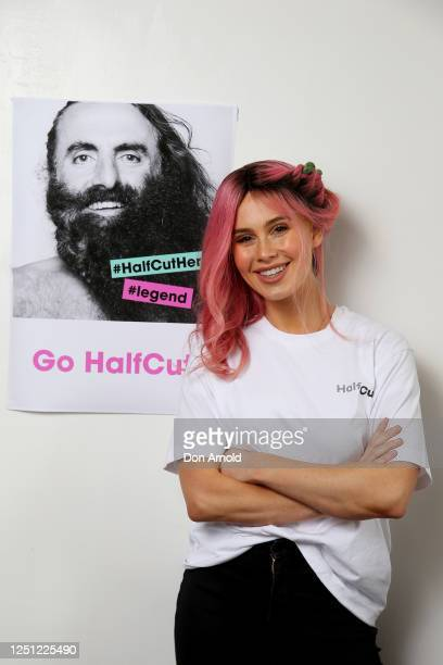 Tigerlily poses after having half her hair dyed as part of the Halfcut fundraising movement at Stanley and Co Barber Shop in Chippendale on June 22,...