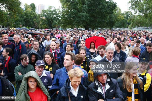 Tigers and Demons fans gather during the 2018 AFL round five match between the Melbourne Demons and the Richmond Tigers at the Melbourne Cricket...