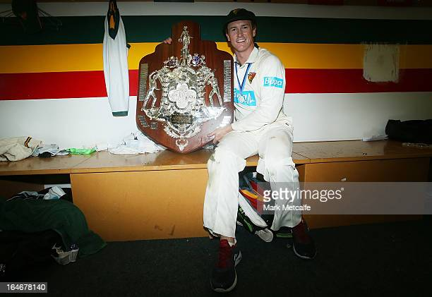 Tigers captain George Bailey poses with the Sheffield Shield trophy after winning the Sheffield Shield final between the Tasmania Tigers and the...