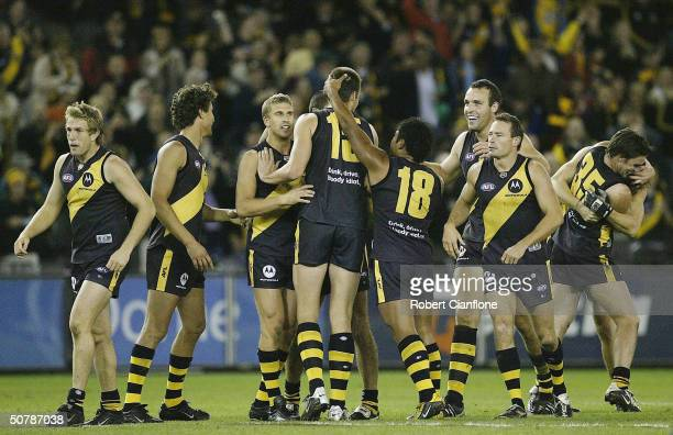 Tigers celebrate after the Tigers defeated the Hawks during the round six AFL match between the Richmond Tigers and the Hawthorn Hawks at the Telstra...