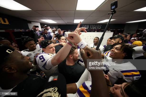 Tigers celebrate in the locker room after their 4225 win over Clemson Tigers in the College Football Playoff National Championship game at Mercedes...