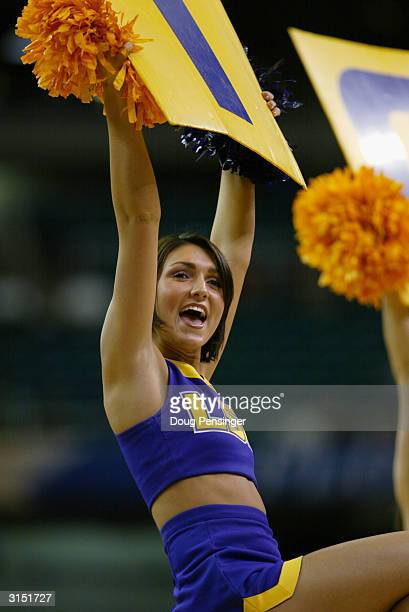 Tigers cheerleader holds up a sign during the second round game of the SEC Men's Basketabll Tournament against the South Carolina Gamecocks on March...