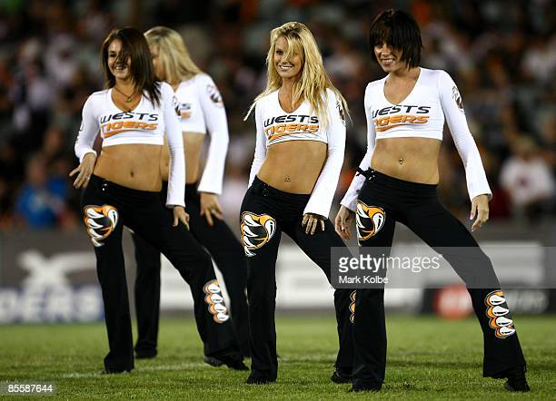 Tigers cheerleaders perform before the round one NRL match between the Wests Tigers and the Canberra Raiders at Campbelltown Sports Stadium on March...