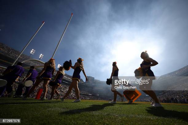 Tigers cheerleaders walk on the field at Tiger Stadium on November 11 2017 in Baton Rouge Louisiana